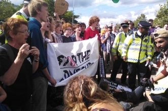 Activists take action against the DSEI arms fair in London.
