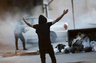 A Bahraini protester during clashes with riot police following a demo to mark the fifth anniversary of the Arab spring-inspired uprising.
