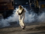 A Bahraini man runs for cover from teargas fired by security forces during clashes following a demonstration against the government in the village of Sitra, south of Manama, on January 1, 2016. AFP PHOTO/MOHAMMED AL-SHAIKH / AFP PHOTO / MOHAMMED AL-SHAIKH