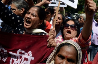 Indian women shout slogans during a protest over claims a Saudi official raped his two maids, near the Saudi Arabian embassy in New Delhi, on 10 September, 2015 (file image) MONEY SHARMA/AFP/Getty Images