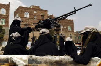 Yemeni female fighters supporting the Shiite Huthi rebels sit in the back of a heavily armed vehicle during an anti-Saudi rally in the capital Sanaa on September 6, 2016. The Saudi-led Arab coalition launched a military campaign against the Huthis and their allies in March 2015, after the rebels closed in on Gulf-backed President Abedrabbo Mansour Hadi in his southern refuge of Aden, forcing him into exile.   / AFP PHOTO / MOHAMMED HUWAIS