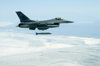 OVER UTAH -- An F-16C Fighting Falcon assigned to the 522nd Fighter Squadron, Cannon Air Force Base, N.M., releases an AGM-154 joint standoff weapon over the Utah Test and Training Range. The mission was part of an air-to-ground weapons system evaluation program mission commonly referred to as Combat Hammer.  The squadron is deployed to Hill AFB, Utah.  (U.S. Air Force photo by Master Sgt. Michael Ammons)