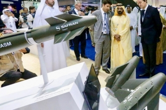 United Arab Emirates Prime Minister and Dubai Ruler Sheikh Mohammed bin Rashid al-Maktoum (2ndR) listens to explanations as he visits the Sagem (Safran group) stand during the International Defence Exhibition and Conference (IDEX) at the Abu Dhabi National Exhibition Centre in the Emirati capital on February 22, 2015. Displayed on the stand in an Air-to-Ground Modular Weapon (AASM) Hammer by Safran. AFP PHOTO / KARIM SAHIB / AFP PHOTO / KARIM SAHIB