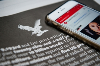 "A smartphone showing the online version of the Independent is placed upon a page of the final print edition of the Independent newspaper showing a round-up of world events and technological developments that occured during the years of publication in London on March 26, 2016. The final print edition of The Independent newspaper went on sale March 26, ending its 30-year appearance on British newsstands with an exclusive on an assassination plot against a former Saudi king. A poignant wrap-around front page carried the words ""STOP PRESS"" in red lettering on a white background, followed by the words ""Read all about it in this, our final print edition - 1986- 2016"".  / AFP PHOTO / LEON NEAL"