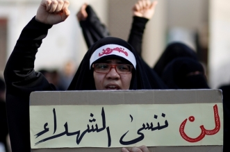 "A protester holds a placard, which reads: ""We will not forget our martyrs"", as she shouts anti-government slogans during the funeral procession for Hassan Al Hayki, who was detained by authorities more than a month ago and died on Sunday, in Manama, Bahrain, August 2, 2016. REUTERS/Hamad I Mohammed"